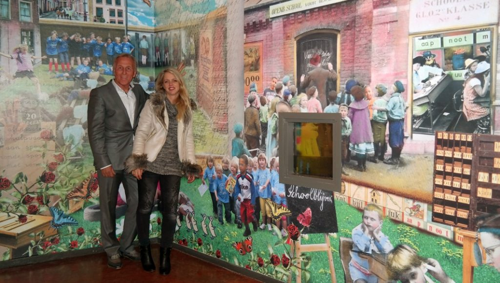 Barbara van Druten and the director, standing in front of the artwork for the public school.